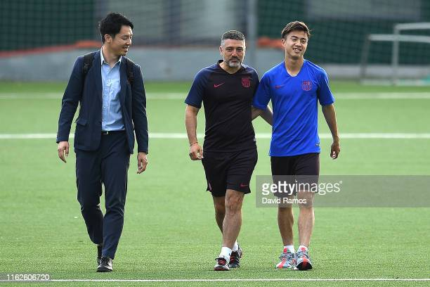 Hiroki Abe and Head coach Francesc Xavier Garcia Pimienta of FC Barcelona B walk onto the pitch prior the press conference at Ciutat Esportiva Joan...
