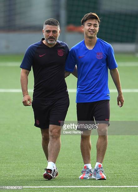 Hiroki Abe and Head coach Francesc Xavier Garcia Pimienta of FC Barcelona B walk onto the pitch prior the press conference at Ciutat Esportiva Joan...