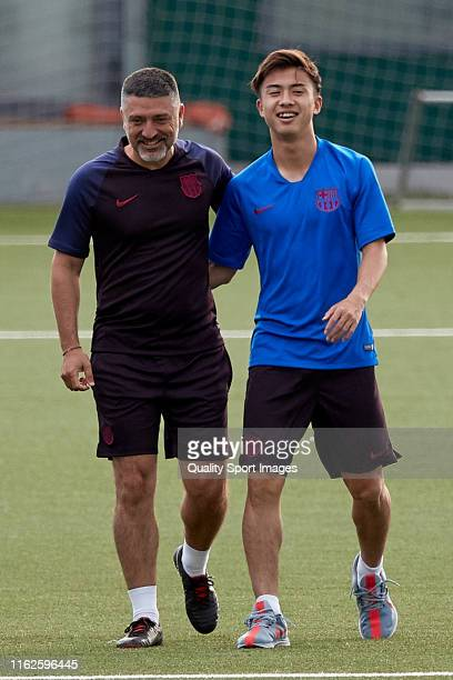 Hiroki Abe of FC Barcelona B walks on with Garcia Pimienta prior the press conference at Ciutat Esportiva Joan Gamper of Sant Joan Despi on July 17...