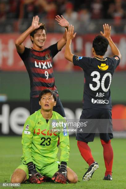 Hiroki Abe of Kashima Antlers celebrates scoring his side's third goal with his team mate Yuma Suzuki during the J.League J1 match between Kashima...