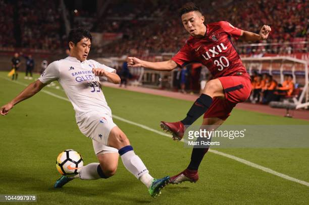 Hiroki Abe of Kashima Antlers passes the ball under pressure during the AFC Champions League semi final first leg match between Kashima Antlers and...