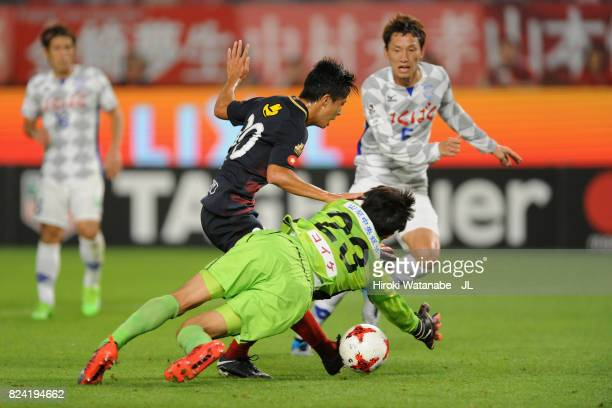 Hiroki Abe of Kashima Antlers scores his side's third goal past Hiroki Oka of Ventforet Kofu during the J.League J1 match between Kashima Antlers and...