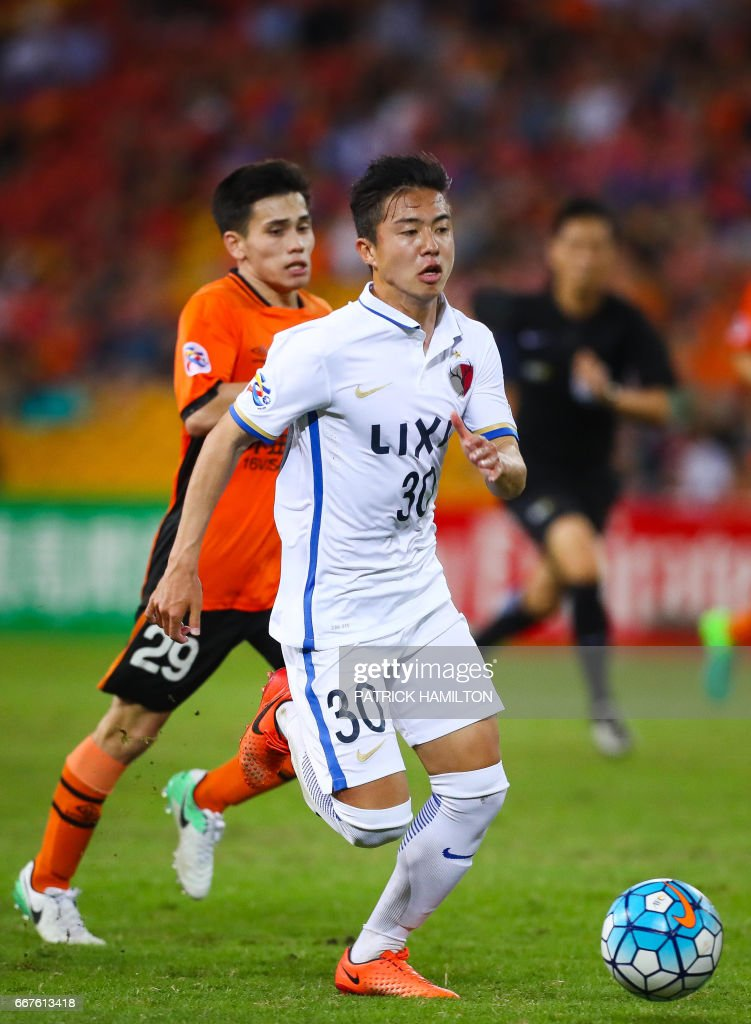 Hiroki Abe of the Kashima Antlers controls the ball during the AFC ...
