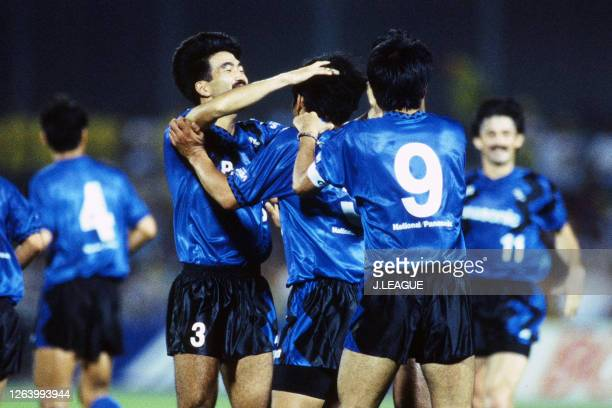 Hiroki Azuma of Gamba Osaka celebrates scoring his side's first goal with his team mates during the J.League Suntory Series match between JEF United...