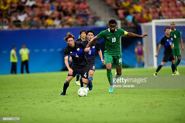 Hiroki Fujharu player of Japan battles for the ball with John Obi Mikel player of Nigeria during 2016 Summer Olympics match between Japan and Nigeria...