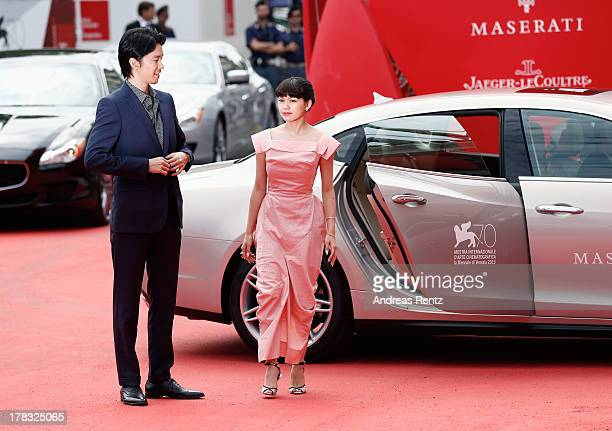 Hiroki Hasegawa and Fumi Nikaido attends Why Don't You Play In Hell Premiere during the 70th Venice International Film Festival on August 29 2013 in...