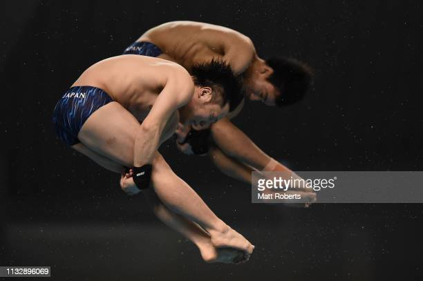 Hiroki Ito and Kazuki Murakami of Japan compete during the Men's 10m Platform Synchro Final on day one of the FINA Diving World Cup Sagamihara at...