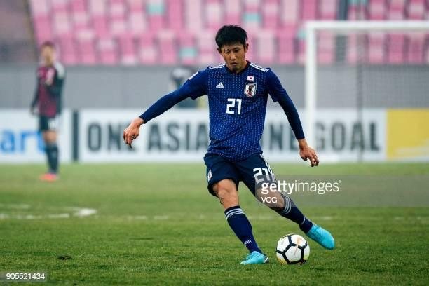 Hiroki Ito of Japan drives the ball during the AFC U-23 Championship Group B match between Japan and North Korea at Jiangyin Stadium on January 16,...
