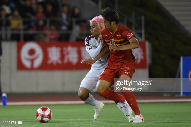 Hiroki Ito of Nagoya Grampus and Atomu Tanaka of Cerezo Osaka compete for the ball during the J.League Levain Cup Group B match between Nagoya...