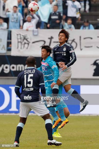 Hiroki Kawano of Sagan Tosu and Tomohiko Miyazaki of Jubilo Iwata compete for the ball during the JLeague J1 match between Sagan Tosu and Jubilo...