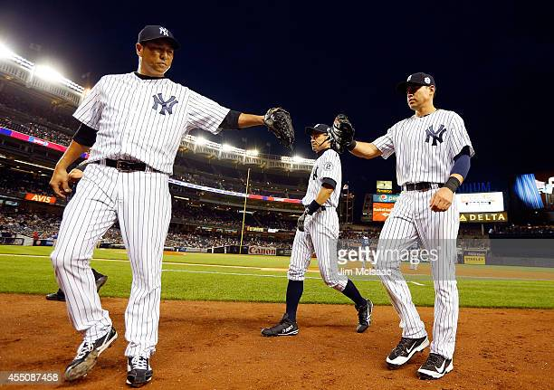 Hiroki Kuroda Ichiro Suzuki and Stephen Drew of the New York Yankees walk to the dugout after the second inning against the Tampa Bay Rays at Yankee...