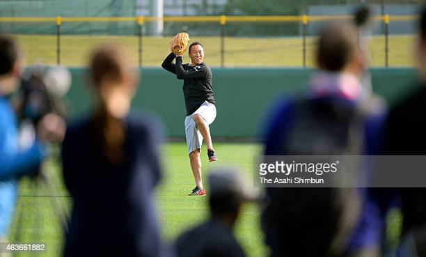 Hiroki Kuroda of Hiroshima Toyo Carp throws while loads of media reporters watch at the Koza Shinkin Stadium on February 17 2015 in Okinawa Japan...