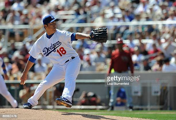 Hiroki Kuroda of the Los Angeles Dodgers pitches during a Spring Training game against the Arizona Diamondbacks at Camelback Ranch on March 10 2009...