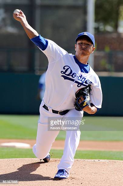 Hiroki Kuroda of the Los Angeles Dodgers throws a pitch as he warms up before the start of the Dodgers home opener spring training game against the...