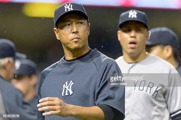 Hiroki Kuroda of the New York Yankees celebrates with teammates after the game against the Cleveland Indians at Progressive Field on July 7 2014 in...