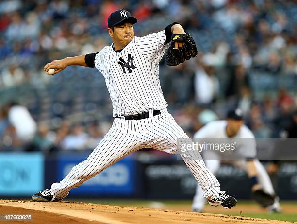 Hiroki Kuroda of the New York Yankees delivers a pitch in the first inning against the Seattle Mariners on May 1 2014 at Yankee Stadium in the Bronx...