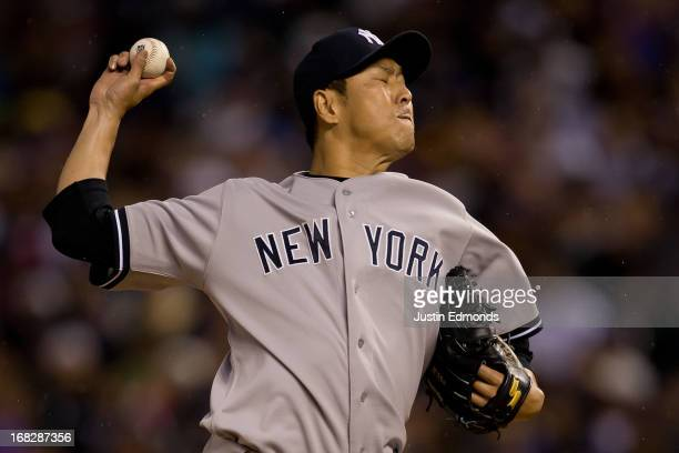 Hiroki Kuroda of the New York Yankees delivers to home plate during the third inning against the Colorado Rockies at Coors Field on May 7 2013 in...