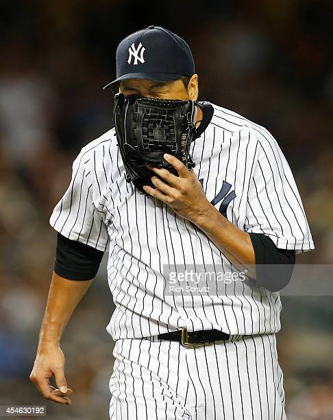 Hiroki Kuroda of the New York Yankees in action during the fifth inning against the Boston Red Sox during a MLB baseball game at Yankee Stadium on...
