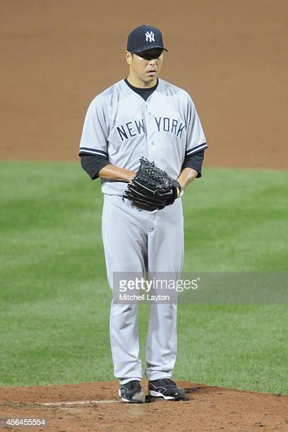 Hiroki Kuroda of the New York Yankees pitches a baseball game against the Baltimore Orioles on September 14 2014 at Oriole Park at Camden Yards in...