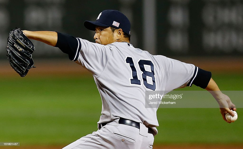 Hiroki Kuroda #18 of the New York Yankees pitches against the Boston Red Sox during the game on September 11, 2012 at Fenway Park in Boston, Massachusetts.