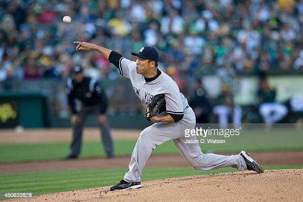 Hiroki Kuroda of the New York Yankees pitches against the Oakland Athletics during the second inning at Oco Coliseum on June 14 2014 in Oakland...