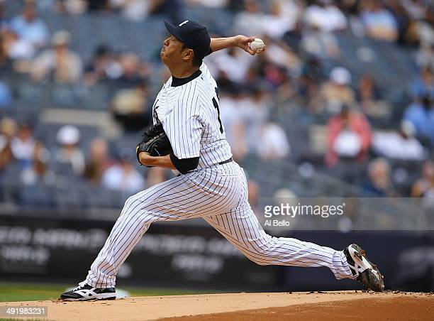 Hiroki Kuroda of the New York Yankees pitches against the Pittsburgh Pirates in the first inning during their game on May 18 2014 at Yankee Stadium...