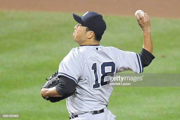 Hiroki Kuroda of the New York Yankees pitches during a baseball game against the Baltimore Orioles on September 14 2014 at Oriole Park at Camden...