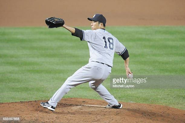 Hiroki Kuroda of the New York Yankees pitches in seventh inning during a baseball game against the Baltimore Orioles on September 14 2014 at Oriole...