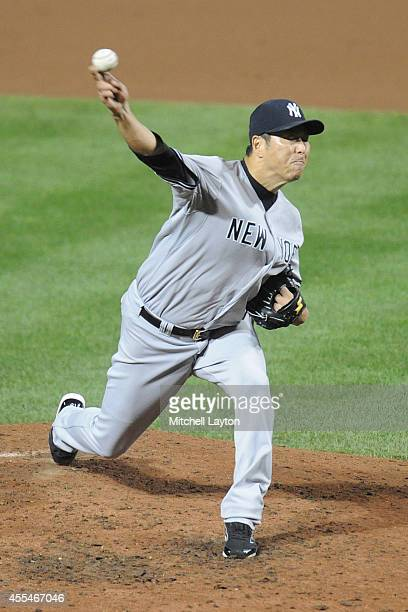 Hiroki Kuroda of the New York Yankees pitches in sixth inning during a baseball game against the Baltimore Orioles on September 14 2014 at Oriole...