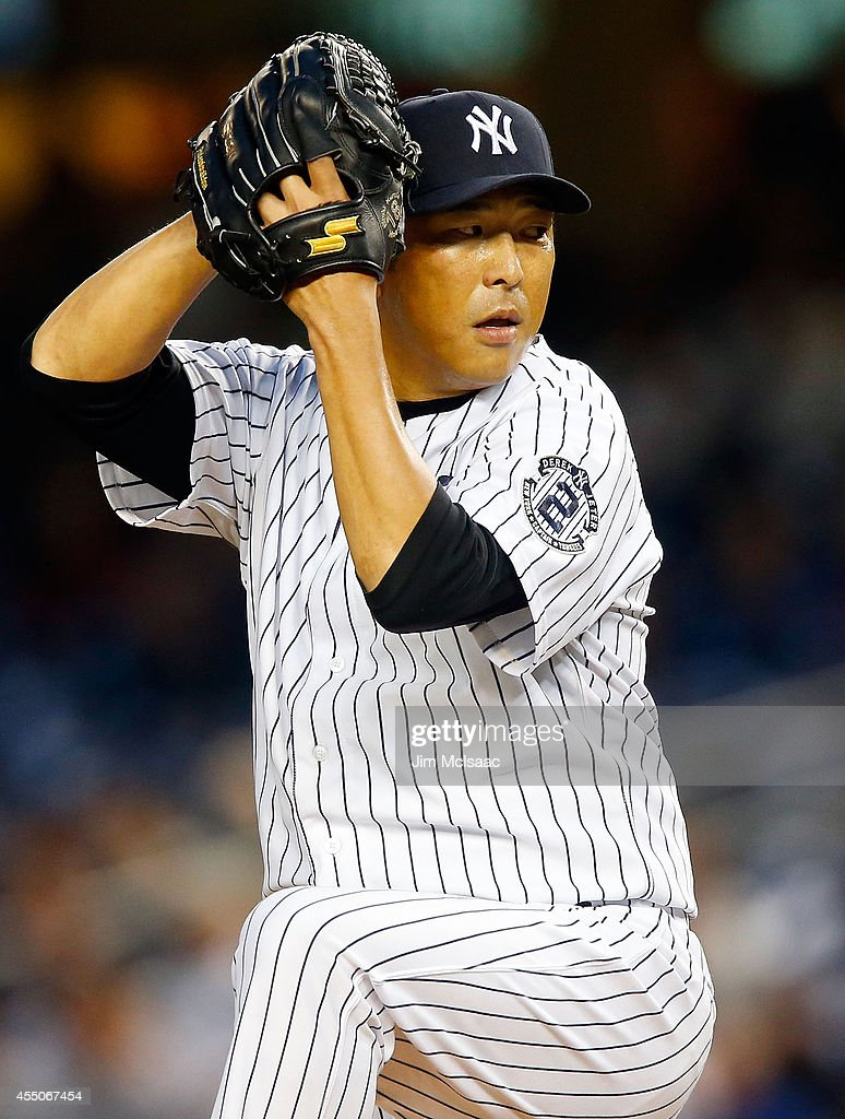 Hiroki Kuroda #18 of the New York Yankees pitches in the first inning against the Tampa Bay Rays at Yankee Stadium on September 9, 2014 in the Bronx borough of New York City.
