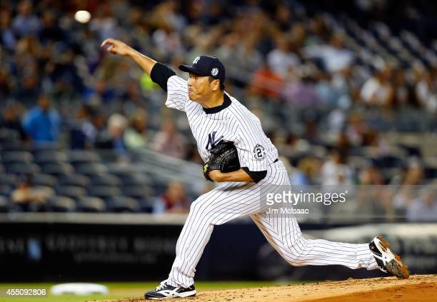 Hiroki Kuroda of the New York Yankees pitches in the second inning against the Tampa Bay Rays at Yankee Stadium on September 9 2014 in the Bronx...