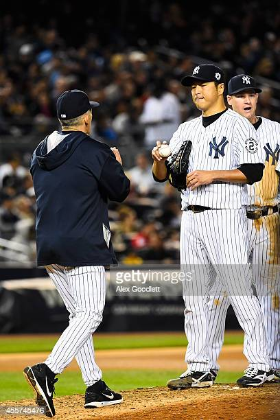 Hiroki Kuroda of the New York Yankees reacts after being relieved in the seventh inning against the Toronto Blue Jays at Yankee Stadium on September...