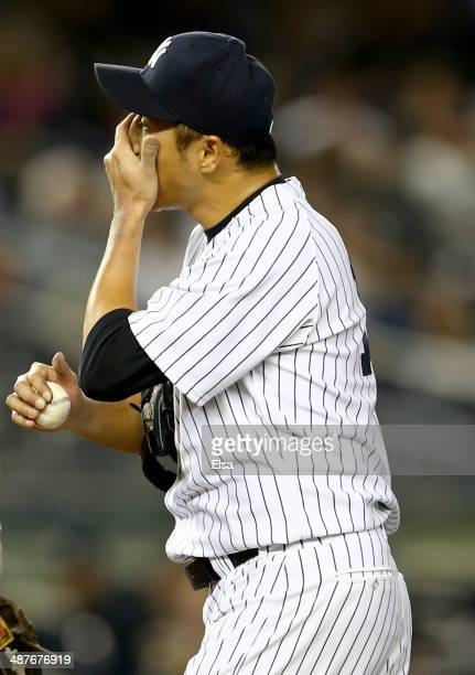 Hiroki Kuroda of the New York Yankees reacts during the fourth inning against the Seattle Mariners on May 1 2014 at Yankee Stadium in the Bronx...