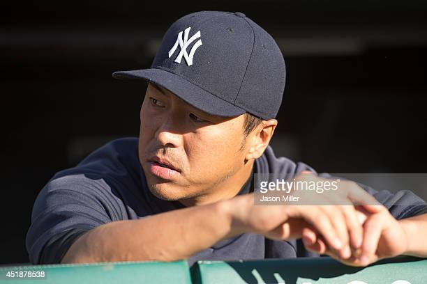 Hiroki Kuroda of the New York Yankees sits in the dugout prior to the game against the Cleveland Indians at Progressive Field on July 8 2014 in...