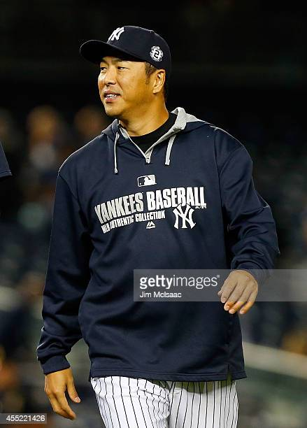 Hiroki Kuroda of the New York Yankees smiles after defeating the Tampa Bay Rays at Yankee Stadium on September 10 2014 in the Bronx borough of New...