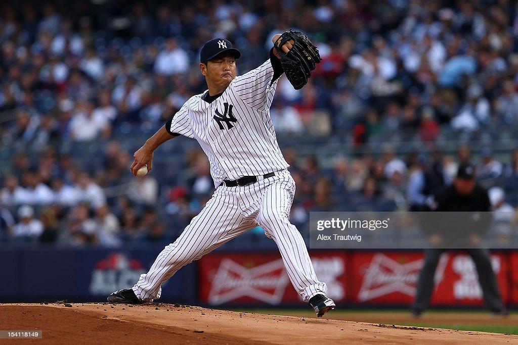 Hiroki Kuroda #18 of the New York Yankees throws a pitch against the Detroit Tigers during Game Two of the American League Championship Series at Yankee Stadium on October 14, 2012 in the Bronx borough of New York City.