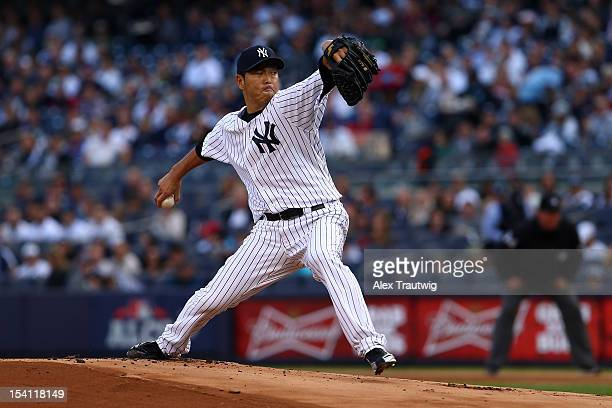 Hiroki Kuroda of the New York Yankees throws a pitch against the Detroit Tigers during Game Two of the American League Championship Series at Yankee...