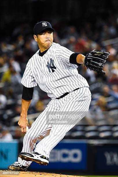 Hiroki Kuroda of the New York Yankees throws a pitch in the first inning against the Toronto Blue Jays at Yankee Stadium on September 19 2014 in the...