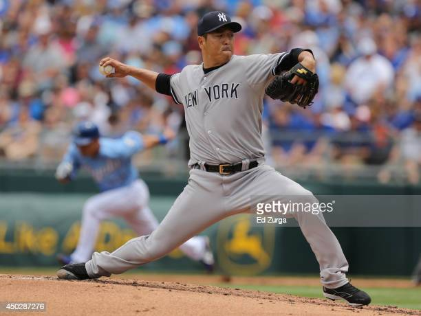 Hiroki Kuroda of the New York Yankees throws in the first inning during a game against the Kansas City Royals at Kauffman Stadium on June 8 2014 in...