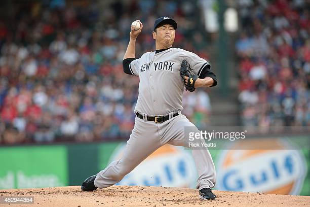 Hiroki Kuroda of the New York Yankees throws in the first inning against the Texas Rangers at Globe Life Park in Arlington on July 30, 2014 in...