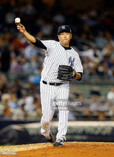 Hiroki Kuroda of the New York Yankees throws to first base in the fourth inning against the Tampa Bay Rays at Yankee Stadium on September 9 2014 in...