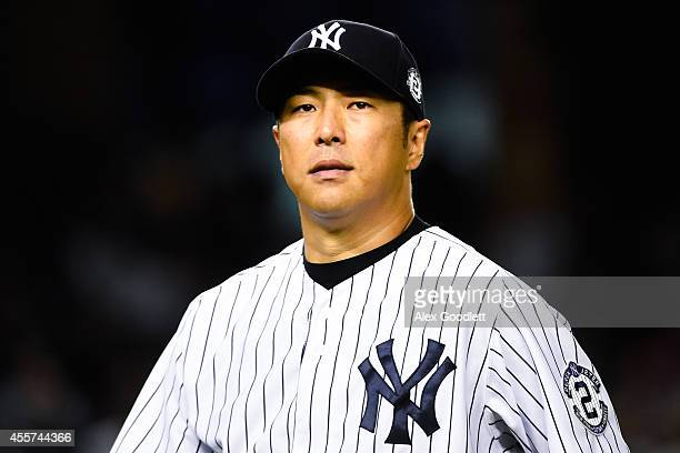 Hiroki Kuroda of the New York Yankees walks off the field during a game against the Toronto Blue Jays at Yankee Stadium on September 19 2014 in the...