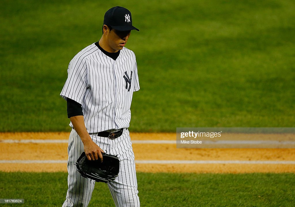 Hiroki Kuroda #18 of the New York Yankees walks off the mound in the fifth inning against the Tampa Bay Rays at Yankee Stadium on September 24, 2013 in the Bronx borough of New York City. The Rays defeated the Yankees 7-0.
