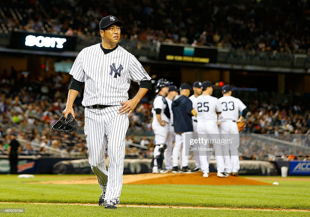Hiroki Kuroda #18 of the New York Yankees walks to the dugout as he leaves a game against the Tampa Bay Rays in the fourth inning at Yankee Stadium on September 9, 2014 in the Bronx borough of New York City.