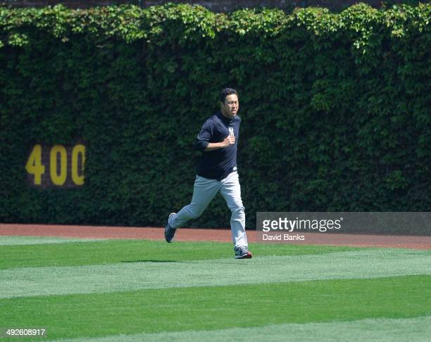 Hiroki Kuroda of the New York Yankees warms up before the game against the Chicago Cubs on May 21 2014 at Wrigley Field in Chicago Illinois