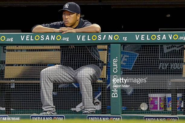 Hiroki Kuroda of the New York Yankees watches the game from the dugout during the sixth inning against the Cleveland Indians at Progressive Field on...