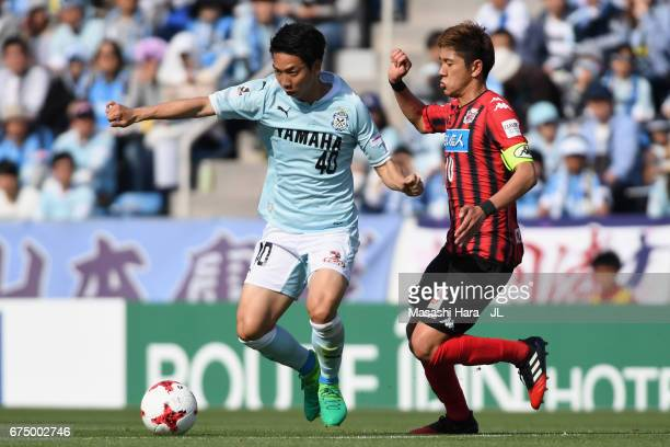 Hiroki Miyazawa of Consadole Sapporo and Hayao Kawabe of Jubilo Iwata compete for the ball during the JLeague J1 match between Jubilo Iwata and...
