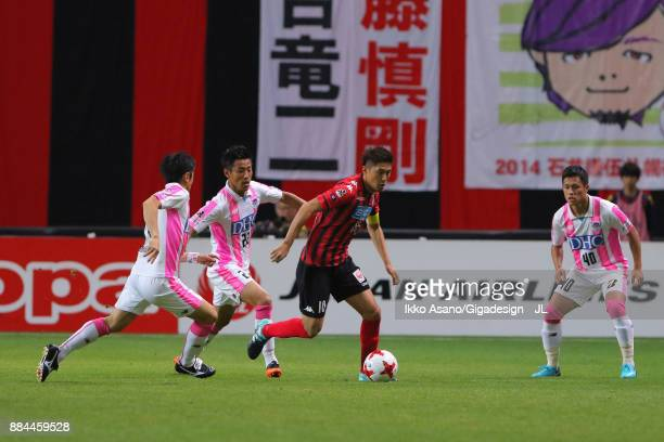 Hiroki Miyazawa of Consadole Sapporo controls the ball under pressure of Sagan Tosu defense during the JLeague J1 match between Consadole Sapporo and...