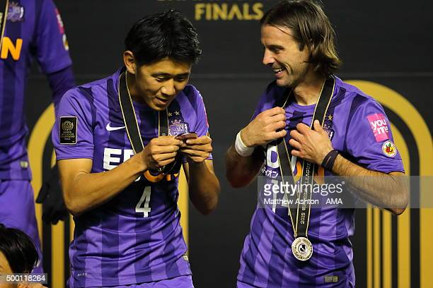 Hiroki Mizumoto and Mihael Mikic of Sanfrecce Hiroshima look at their winners medals during the JLeague 2015 Championship final 2nd leg match between...