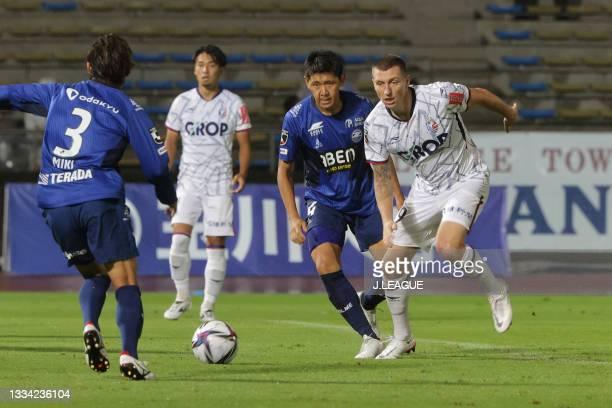 Hiroki MIZUMOTO of FC Machida Zelvia and MITCHELL DUKE of Fagiano Okayama tussle during the J.League Meiji Yasuda J2 match between Machida Zelvia and...